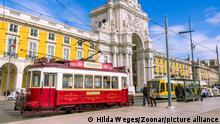 LISBON, PORTUGAL - March 5, 2016: : Old colorful tramcars on square Praca de Comercio in Lisbon Portugal.