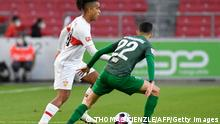 Stuttgart's German midfielder Daniel Didavi (L) and Augsburg's Brazilian defender Amaral Borduchi Iago vie for the ball during the German first division Bundesliga football match VfB Stuttgart v FC Augsburg in Stuttgart, southern Germany on May 7, 2021. - DFL REGULATIONS PROHIBIT ANY USE OF PHOTOGRAPHS AS IMAGE SEQUENCES AND/OR QUASI-VIDEO (Photo by Thomas KIENZLE / AFP) / DFL REGULATIONS PROHIBIT ANY USE OF PHOTOGRAPHS AS IMAGE SEQUENCES AND/OR QUASI-VIDEO (Photo by THOMAS KIENZLE/AFP via Getty Images)