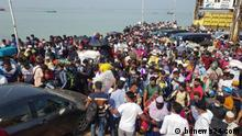 Title: Bangladeshi people leaving capital to observe Eid festival Description: Heavy crowds of people returning home for Eid have descended on Munshiganj's Shimulia port despite pandemic health restrictions on Friday, 07 May. Copyright: bdnews24.com