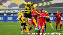 Dortmund's German midfielder Emre Can (C-L, top) and Leipzig's Spanish midfielder Dani Olmo (C-R) vie for the ball during the German first division Bundesliga football match BVB Borussia Dortmund v RB Leipzig in Dortmund, western Germany on May 8, 2021. - DFL REGULATIONS PROHIBIT ANY USE OF PHOTOGRAPHS AS IMAGE SEQUENCES AND/OR QUASI-VIDEO (Photo by LEON KUEGELER / POOL / AFP) / DFL REGULATIONS PROHIBIT ANY USE OF PHOTOGRAPHS AS IMAGE SEQUENCES AND/OR QUASI-VIDEO (Photo by LEON KUEGELER/POOL/AFP via Getty Images)