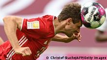 TOPSHOT - Bayern Munich's German forward Thomas Mueller heads the ball during the German first division Bundesliga football match FC Bayern Munich v Borussia Moenchengladbach in Munich, southern Germany on May 8, 2021. - - DFL REGULATIONS PROHIBIT ANY USE OF PHOTOGRAPHS AS IMAGE SEQUENCES AND/OR QUASI-VIDEO (Photo by CHRISTOF STACHE / POOL / AFP) / DFL REGULATIONS PROHIBIT ANY USE OF PHOTOGRAPHS AS IMAGE SEQUENCES AND/OR QUASI-VIDEO (Photo by CHRISTOF STACHE/POOL/AFP via Getty Images)