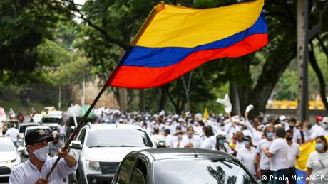 A Colombian protester waves a flag.