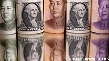 FILE PHOTO: Chinese Yuan and U.S. dollar banknotes are seen in this illustration taken February 10, 2020. REUTERS/Dado Ruvic/Illustration/File Photo