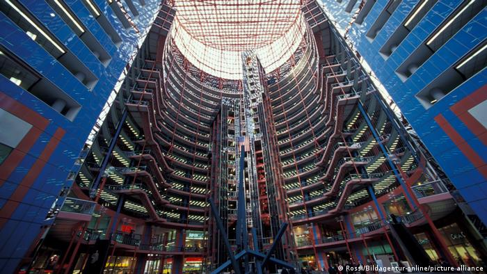 The interior of the James R. Thompson Center in red and blue designs.