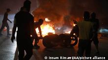 RAMALLAH, WEST BANK - MAY 10: Palestinians burn tires during a demonstration against Israeli violations towards Palestinians in eastern Jerusalem on May 10, 2021 in Ramallah, West Bank Issam Rimawi / Anadolu Agency
