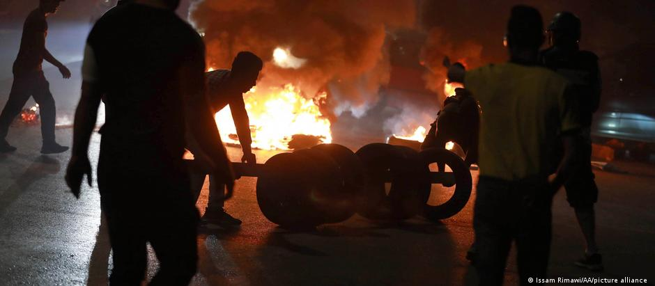 Palestinians burn tires during a demonstration in Ramallah over the recent unrest in East Jerusalem.