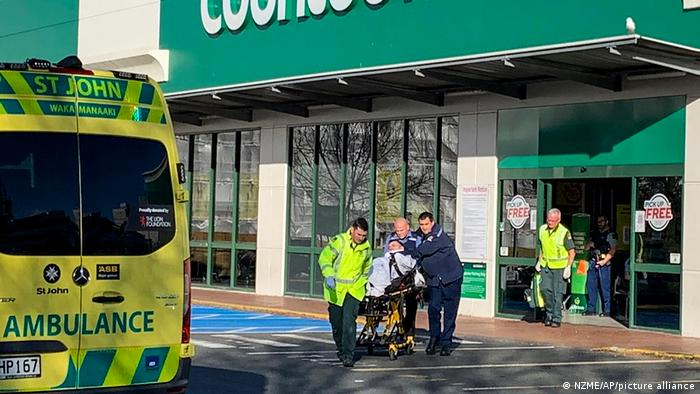 First responders take a victim to an ambulance outside a Countdown supermarket in central Dunedin