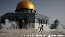 Tear gas outside the Al-Aqsa mosque in Jerusalem