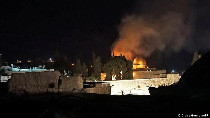 A grab from an AFPTV video shows a tree on fire near Jerusalem's Al-Aqsa mosque complex