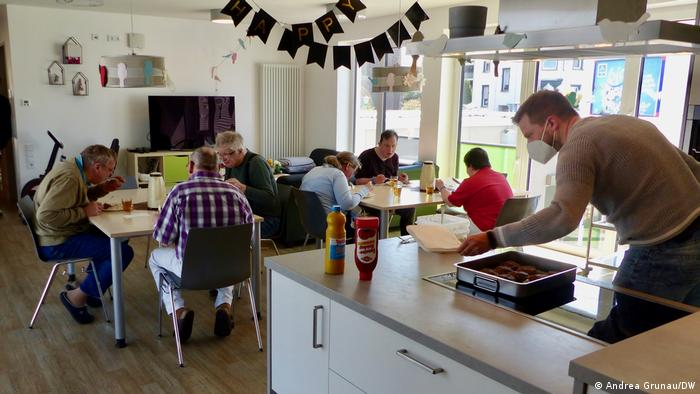Residents having a meal in the kitchen