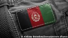 Tag on dark clothing in the form of the flag of the Afghanistan.