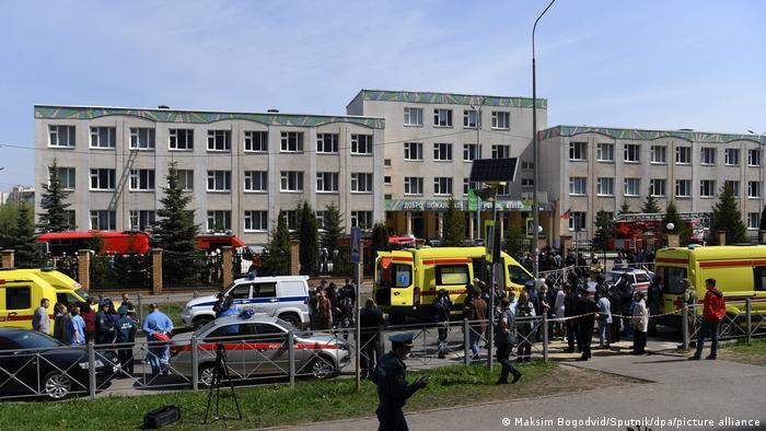 Police and paramedics work at the scene of a shooting at Gymnasium No. 175 in Kazan
