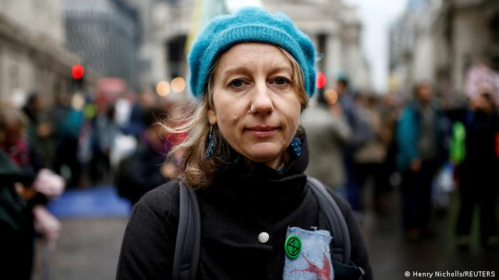 Cofounder of the Extinction Rebellion group, Gail Bradbrook poses as she and others block the road during an Extinction Rebellion demonstration