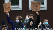 MINSK, BELARUS - OCTOBER 29, 2020: Demonstrators hold signs with messages reading I/we are Belarusian State Medical University and Silence is a sign of consent during a protest in support of students of the Belarusian State Medical University. On 27 October, the president of Belarus announced plans to expel students from universities for taking part in opposition protests. Mass protests organised by the opposition have been taking place in Belarus after the 9 August presidential election. Stringer/TASS