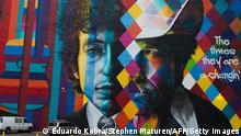 A mural of songwriter Bob Dylan by Brazilian artist Eduardo Kobra is on display in downtown Minneapolis, Minnesota on October 15, 2016. On October 13, 2016, Dylan was awarded the Nobel Prize in Literature. Dylan is the second Nobel laureate in literature from Minnesota after Sinclair Lewis, whose biting satire of Midwestern life and the race to materialism won him the prize in 1930, a first by an American. Dylan's Nobel comes months after Minnesota's other musical luminary -- Prince, who proudly associated himself with the Minneapolis area -- died of an accidental painkiller overdose. / AFP / STEPHEN MATUREN / TO GO WITH AFP STORY by Shaun TANDON, For Dylan, aura of mystery extends to hometown RESTRICTED TO EDITORIAL USE - MANDATORY MENTION OF THE ARTIST UPON PUBLICATION - TO ILLUSTRATE THE EVENT AS SPECIFIED IN THE CAPTION (Photo credit should read STEPHEN MATUREN/AFP via Getty Images)
