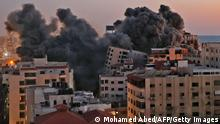 Smoke billows from an Israeli airstrike on a 13-storey building in Gaza