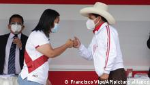 Presidential candidates, Keiko Fujimori of the Popular Force party, and Pedro Castillo of the Free Peru party, fist bump at the end of a presidential debate, in Chota, Peru, Saturday, May 1, 2021. The second round candidates arrived in the small town in the country's northern highlands for their first presidential debate ahead of the June 6th runoff election. (AP Photo/Francisco Vigo)