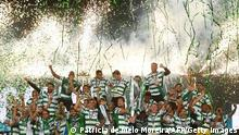 Sporting´s players celebrate with the trophy after winning the Portuguese football League title at the Jose Alvalade stadium in Lisbon on May 11, 2021. (Photo by PATRICIA DE MELO MOREIRA / AFP) (Photo by PATRICIA DE MELO MOREIRA/AFP via Getty Images)