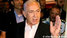 Israeli Prime Minister Benjamin Netanyahu tours the city of Lod early on May 12, 2021. - Israeli Prime Minister Benjamin Netanyahu on May 12 declared a state of emergency in the central city of Lod as police accused Arab residents of waging wide-scale riots. (Photo by AHMAD GHARABLI / AFP)