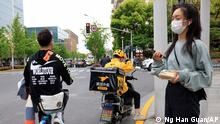 A Meituan delivery man in yellow goes on his rounds in Shanghai on Wednesday, April 21, 2021. China's market regulator on Monday, April 26, 2021 said it launched an investigation into suspected monopolistic behavior by food delivery firm Meituan, months after it investigated e-commerce company Alibaba as Beijing steps up scrutiny of anti-competitive behavior in the internet sector. (AP Photo/Ng Han Guan)