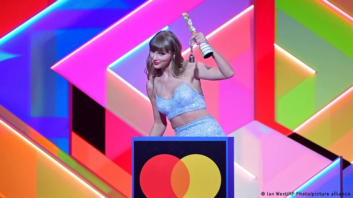 Taylor Swift with her award at the BRITs