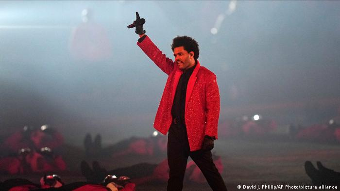 Canadian rapper The Weeknd performing live at the 2021 Super Bowl halftime show.