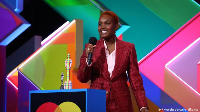 Arlo Parks smiling during her acceptance speech at the Brit Awards.