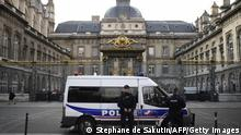 Policemen stand guard outside the Paris courthouse on November 2, 2017, during the last day of the trial of Abdelkader Merah, brother of Mohamed Merah, a jihadist who shot dead seven people, including three French soldiers and three Jewish children, in 2012. Abdelkader is accused of knowingly facilitating his brother's attacks on a Jewish school in the southwestern city of Toulouse, in which a rabbi, two of the rabbi's children, aged three and five, and an eight-year-old girl were killed. / AFP PHOTO / STEPHANE DE SAKUTIN (Photo credit should read STEPHANE DE SAKUTIN/AFP via Getty Images)