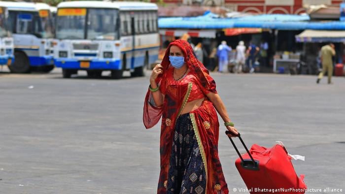 Woman at a bus stand