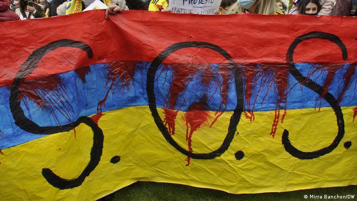 Marcha de manifestantes colombianos y extranjeros en Bruselas, sede central de la Unión Europea