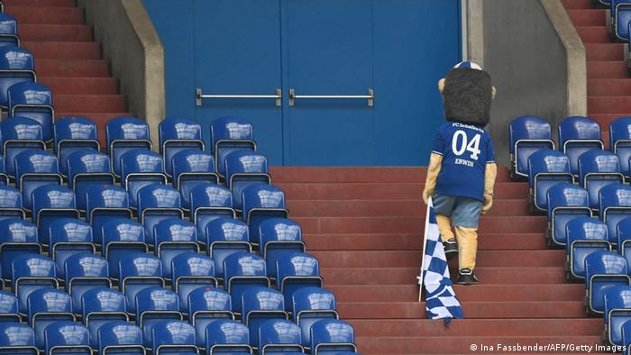Schalke's mascot Erwin leaves the stands