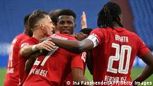 Berlin's team celebrates the 1-2 during the German first division Bundesliga football match FC Schalke 04 v Hertha Berlin on May 12, 2021 in Gelsenkirchen, western Germany. - - DFL REGULATIONS PROHIBIT ANY USE OF PHOTOGRAPHS AS IMAGE SEQUENCES AND/OR QUASI-VIDEO (Photo by Ina FASSBENDER / various sources / AFP) / DFL REGULATIONS PROHIBIT ANY USE OF PHOTOGRAPHS AS IMAGE SEQUENCES AND/OR QUASI-VIDEO (Photo by INA FASSBENDER/POOL/AFP via Getty Images)