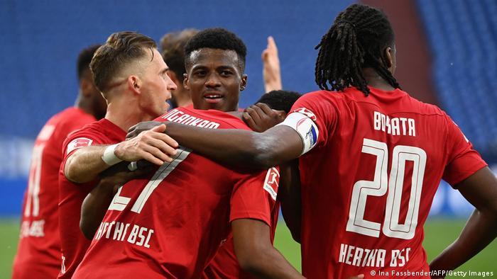 Hertha Berlin's players celebrate their winning goal against Schalke