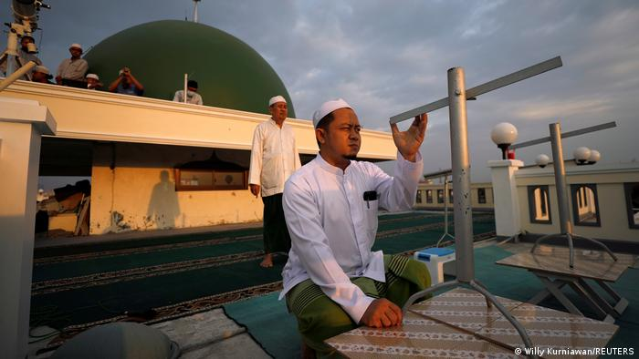 Muslims in Jakarta, Indonesia, use traditional tools to site the crescent moon
