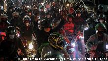May 9, 2021, Bekasi, West Java, Indonesia: The atmosphere of the density of motorcyclists who will pass through the homecoming sealing post in Kedungwaringin, Bekasi Regency, West Java, Sunday (05/09/2021). On H-3 ahead of Eid al-Fitr 1442 H joint officers from the Army, Police, tightened the guard of travelers at the border of Bekasi and Karawang districts to prevent the spread of the Covid-19 virus. (Credit Image: © Muhammad Zaenuddin/ZUMA Wire