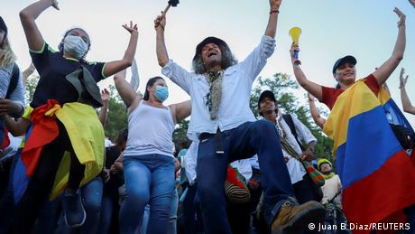 Demonstrators dance during protests in Cali, Colombia