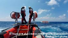 03.08.2019***A dinghy boat of the Ocean Viking ship, operated by the NGOs Sos Mediterranee and Doctors Without Borders, approaches a dinghy boat with migrants in the Mediterranean Sea, Tuesday, Aug. 13, 2019. More than 500 rescued migrants are stuck in the Mediterranean on two NGO boats, as Italy and Malta continue to deny them access to their ports. French charity group Doctors Without Borders (MSF) said late Monday in a tweet that it had completed a critical rescue of another 105 people onto the Ocean Viking, raising the total number of migrants on board ship to 356. (Hannah Wallace Bowman/MSF/SOS Mediterranee via AP)