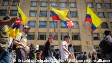 May 31, 2018 - Bogota, Colombia - A group of Protestants marches down the seventh avenue carrying flags of Colombia..After the presidential elections in Colombia on May 27, some alterations have been found in the formats of vote counting. The total numbers of votes have been altered to give more votes to certain candidates. On May 31, a march was organized to demand that the National Registry of Colombia act in this regard