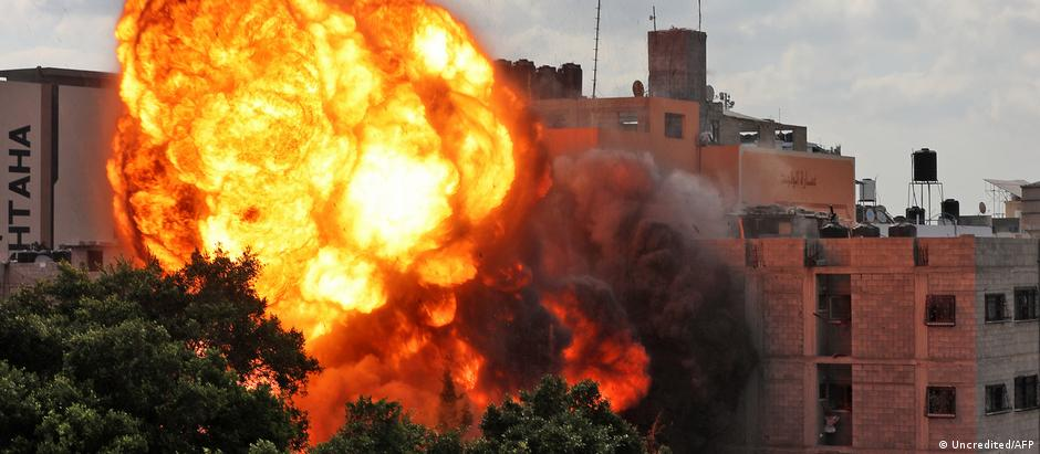 A picture taken on May 13, 2021 shows a ball of fire engulfing the Al-Walid building which was destroyed in an Israeli airstrike on Gaza city early in the morning.
