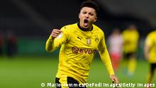 BERLIN, GERMANY - MAY 13: (BILD ZEITUNG OUT) Jadon Sancho of Borussia Dortmund celebrates after scoring his team's first goal during the DFB Cup final match between RB Leipzig and Borussia Dortmund at Olympic Stadium on May 13, 2021 in Berlin, Germany. Sporting stadiums around Germany remain under strict restrictions due to the Coronavirus Pandemic as Government social distancing laws prohibit fans inside venues resulting in games being played behind closed doors. (Photo by Mario Hommes/DeFodi Images via Getty Images)