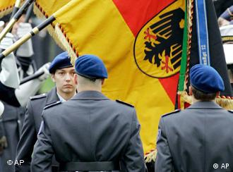 Recruits in front of German flag