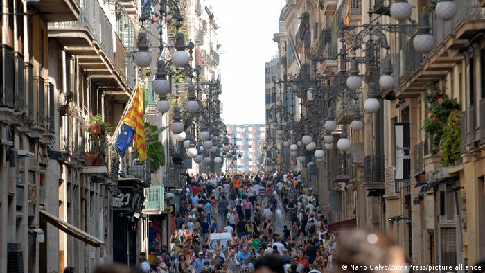 Crowds fill Las Ramblas, the main boulevard in Barcelona