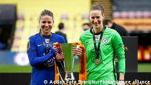 WATFORD, ENGLAND - MARCH 14:L-R Chelsea Ladies Melanie Leupolz and Chelsea Ladies Ann-Katrin Berger holding Trophy after FA Women's Continental Tyre League Cup Final between Bristol City and Chelsea at Vicarage Road Stadium , Watford, UK on 14th March 2021 (Photo by Action Foto Sport/NurPhoto)