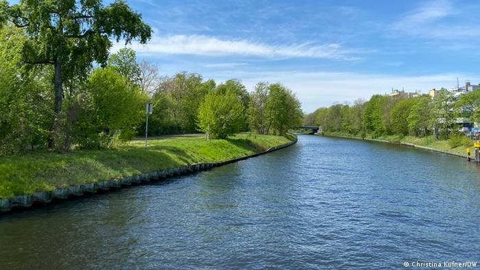 Berlin's Spree river canal with green banks as seen from a boat