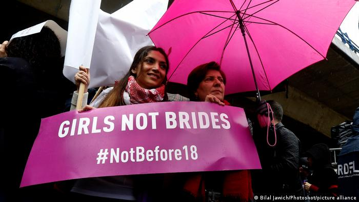 Protesters hold banners against child marriage in Beirut, Lebanon.