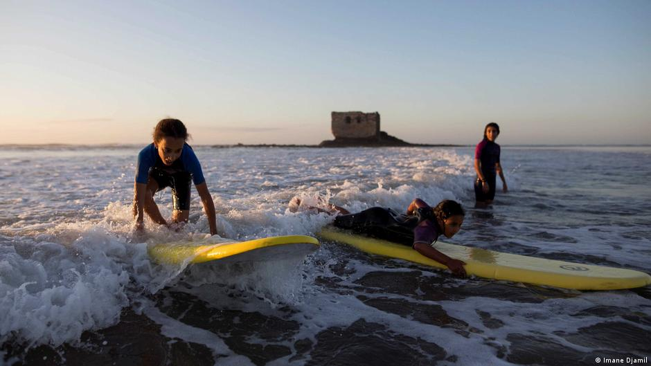 Young children surfing along Morocco's coast