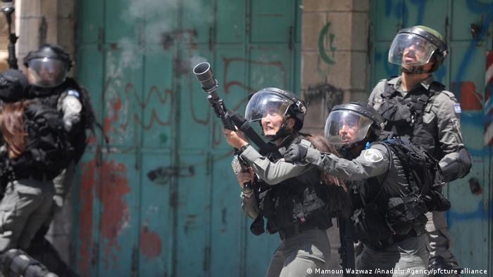 Israeli forces intervene during a protest in the West Bank