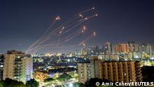 Streaks of light are seen from Ashkelon as Israel's Iron Dome anti-missile system intercepts rockets launched from the Gaza Strip towards Israel, May 15, 2021. REUTERS/Amir Cohen