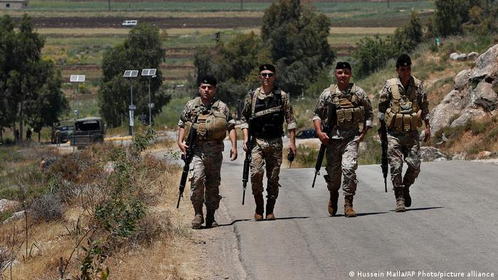 Lebanese army soldiers on a foot patrol at the Lebanese side of the Lebanese-Israeli border
