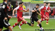 Bayern Munich's Polish forward Robert Lewandowski runs with the ball during the German first division Bundesliga football match between SC Freiburg and FC Bayern Munich in Freiburg, southwestern Germany on May 15, 2021. (Photo by Thomas KIENZLE / POOL / AFP) / DFL REGULATIONS PROHIBIT ANY USE OF PHOTOGRAPHS AS IMAGE SEQUENCES AND/OR QUASI-VIDEO